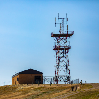 Hilltop cell site tower base station